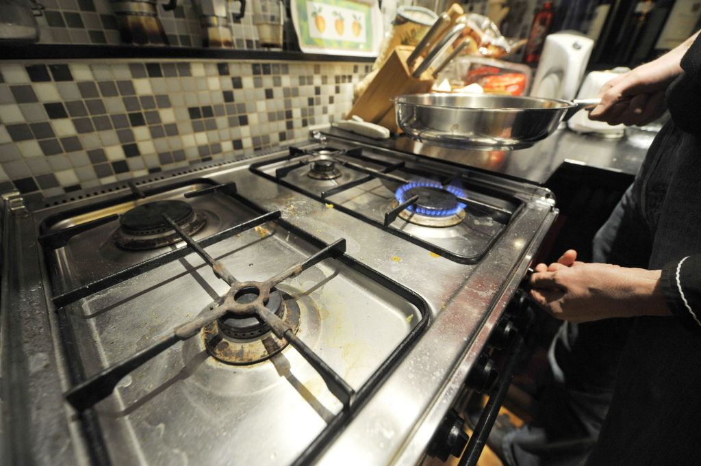 a pan on a gas burner on a stove