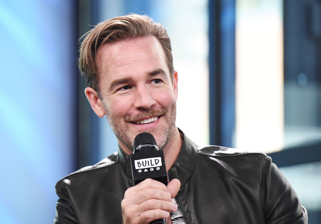 James Van Der Beek smiles and speaks into a microphone