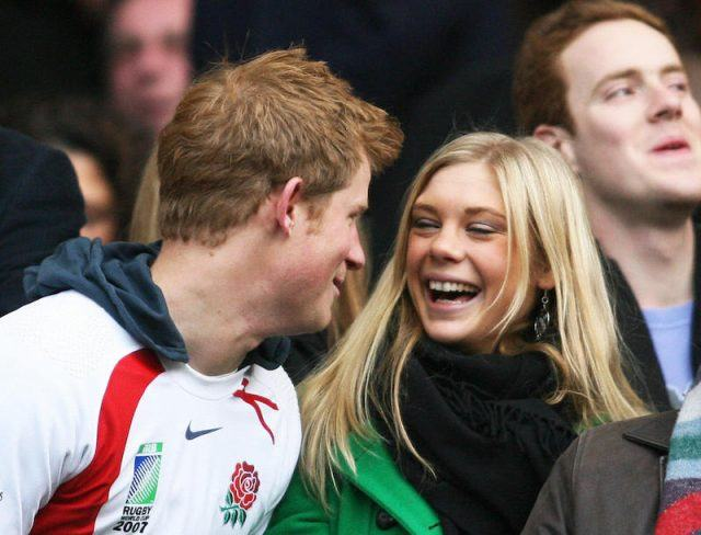 Britain's Prince Harry and Chelsy Davy laugh before the game between South Africa and England at the Investec Challenge international rugby match at Twickenham.