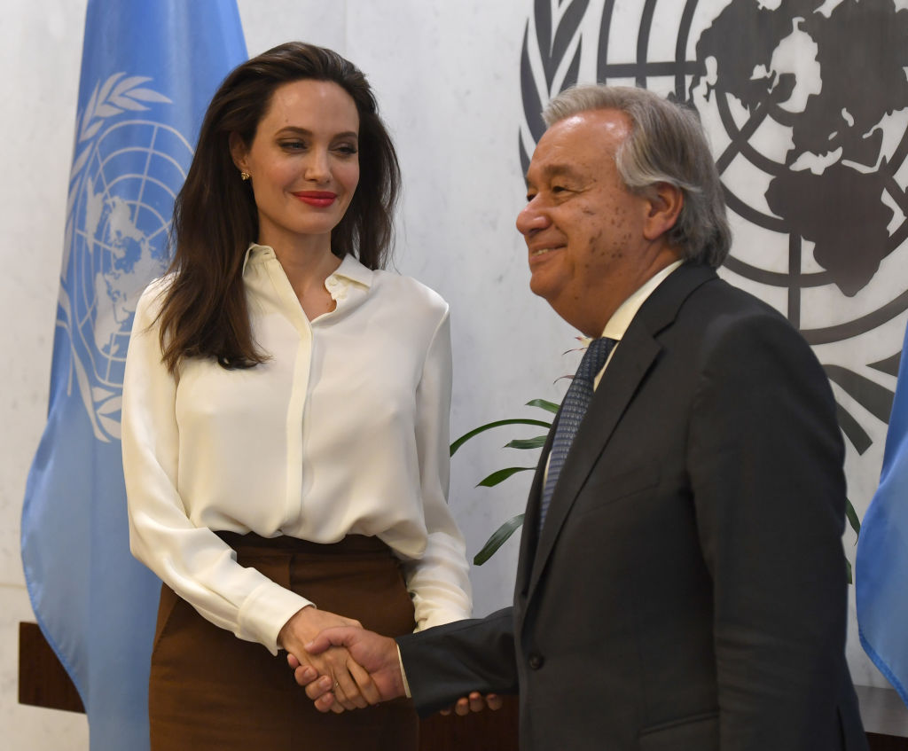 Angelina Jolie shaking hands with UN Secretary-General António Guterres
