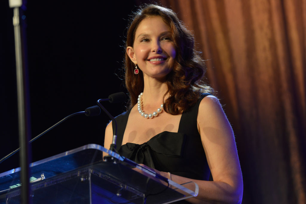 Ashley Judd speaking into a microphone on stage.