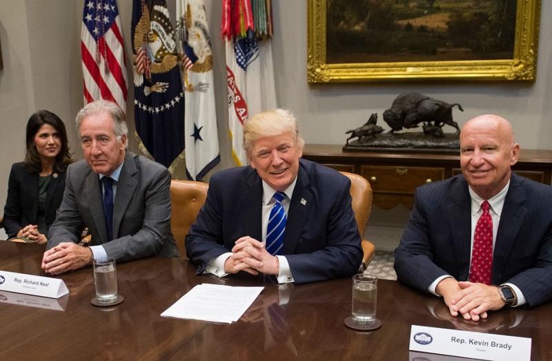 South Dakota House Rep. Kristi Noem seen with Trump in the White House in September 2017