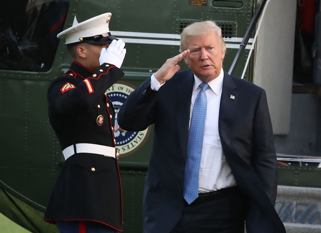 Trump saluting with an air force member