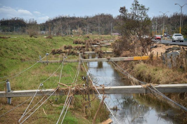 Destroyed electrical posts layed over a ditch on the side of a road by Hurricane Maria is seen in Vega Alta, Puerto Rico