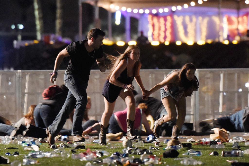 people running holding hands at Las vegas shooting