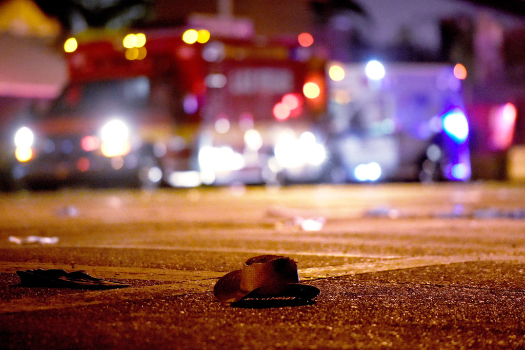 A cowboy hat lays in the street after shots were fired near a country music festival