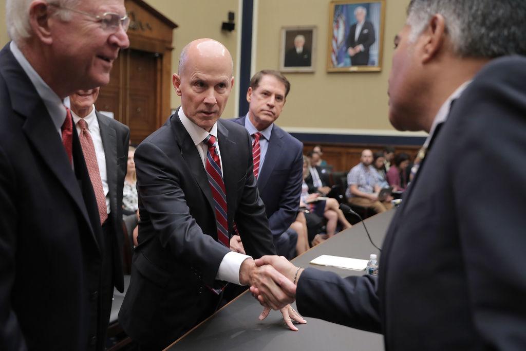CEO shakes politicians' hands