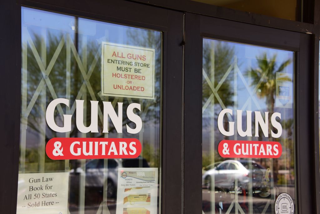 door to guns & guitars shop in white and red