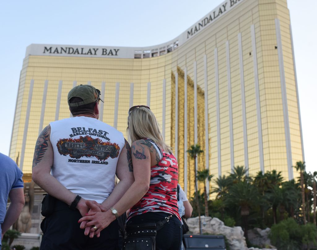 a couple standing in front of mandalay bay hotel