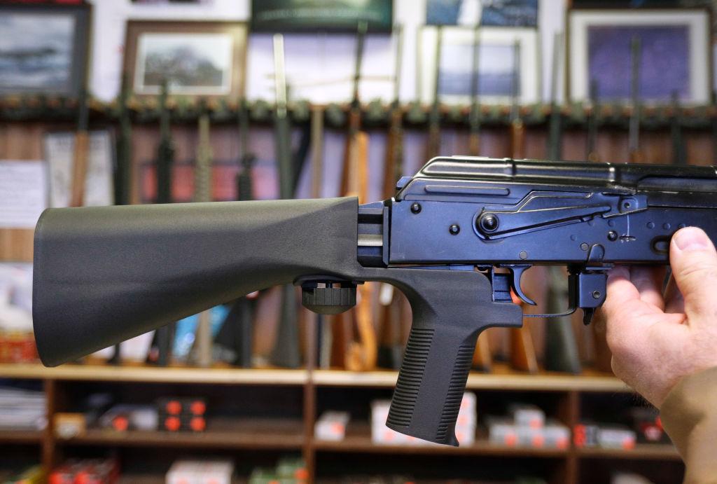 a bump stock on a gun close-up