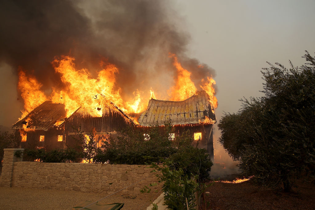 a brown house goes up in flames