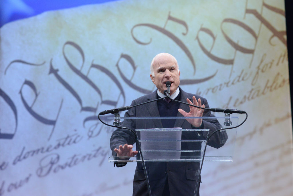 John McCain speaks in philadelphia at a glass podium