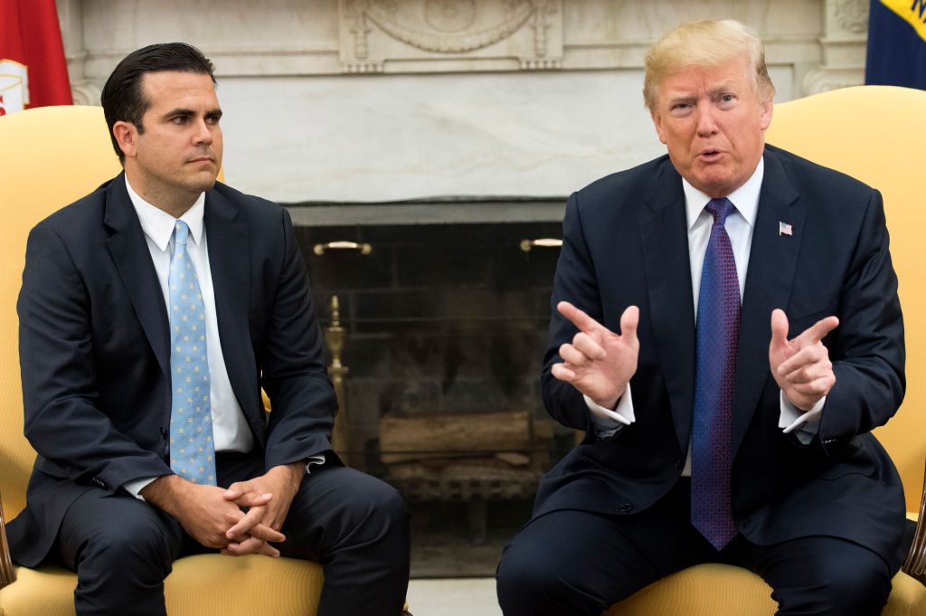 Trump speaks with Ricardo Rossello of Puerto Rico in the Oval Office