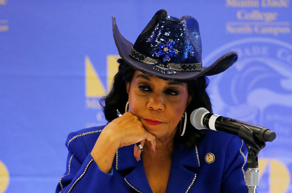 Federicka Wilson in a blue suit and a cowboy hat