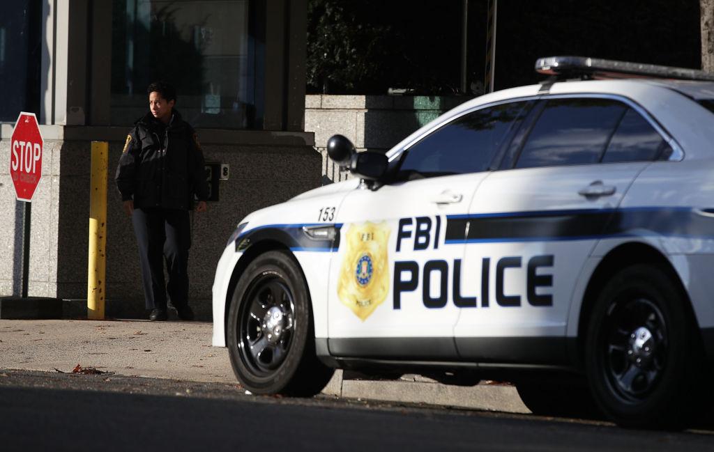 an FBI police car and guard