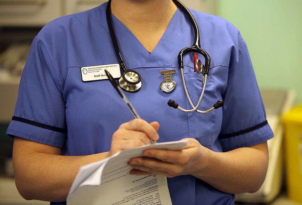 a female nurse in blue scrubs