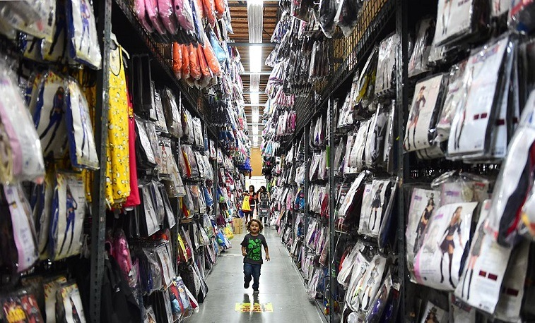 Child in Halloween aisle