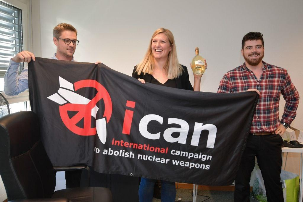 ICAN members pose with banner