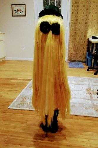 """A person dressed as """"Cousin It"""" from The Addams Family"""