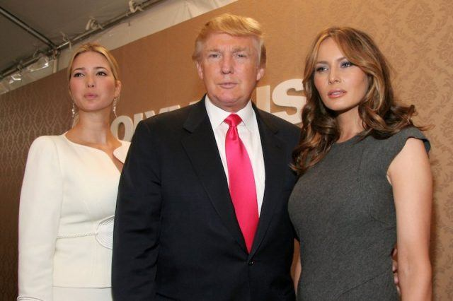 Ivanka, Donald and Melania Trump standing together.