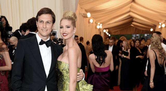 Jared and Ivanka posing on a red carpet.