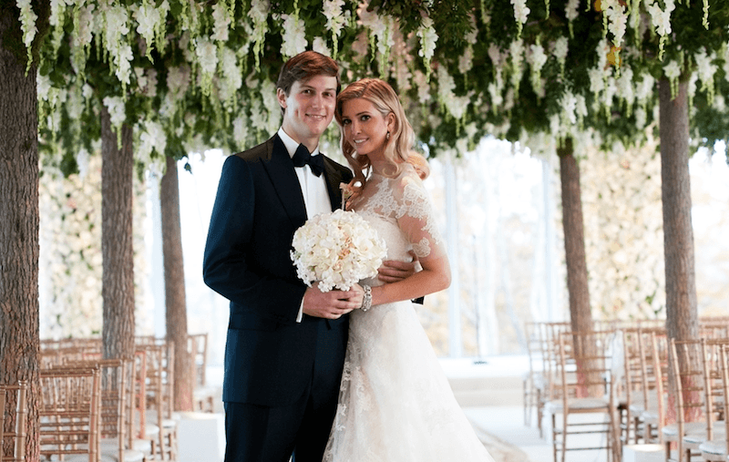 Jared Kushner and Ivanka Trump pose together on their wedding day.
