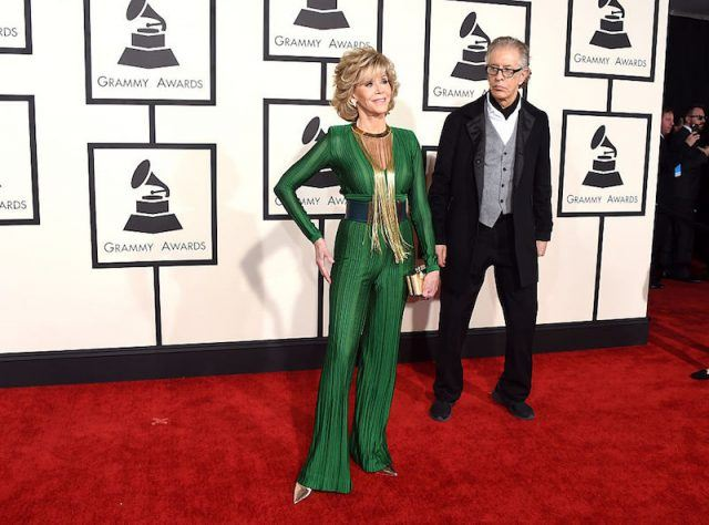 Richard Perry and Jane Fonda pose on a red carpet.
