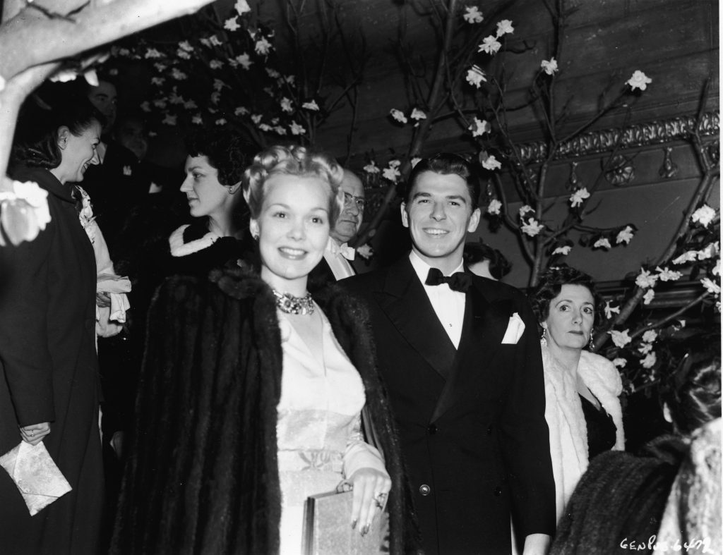 American actor Jane Wyman and her husband, actor and politician Ronald Reagan, attend an unidentified event, 1939. Wyman carries a purse and wears a fur coat over an evening dress while Reagan wears a tuxedo. (Photo by Hulton Archive/Getty Images)