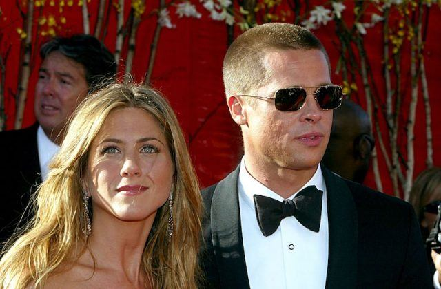 Jennifer Aniston and Brad Pitt standing together at a red carpet event.