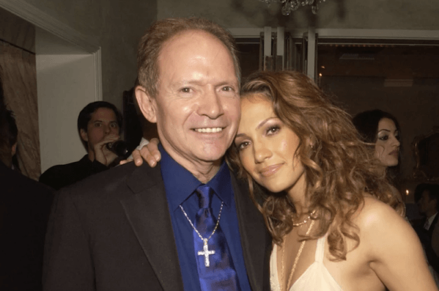 David Lopez and Jennifer Lopez posing for a photo together as she puts her arm around him.
