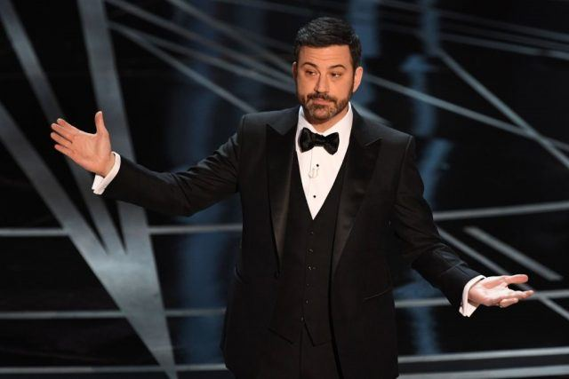 Jimmy Kimmel speaking on stage at the Oscars.