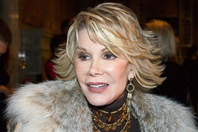 Joan Rivers wearing jewelry and a fur coat at an event.