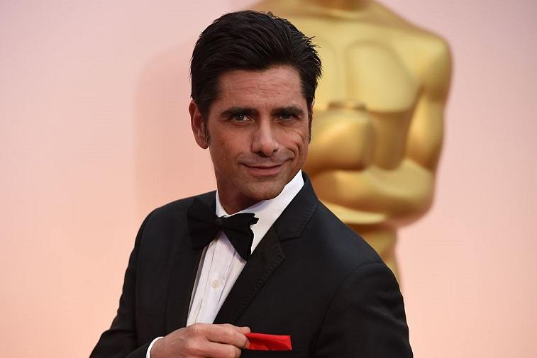 John Stamos arrives at Oscars