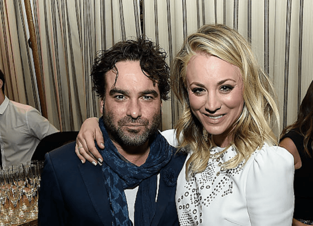 Johnny Galecki and Kaley Cuoco hold each other while posing for a photo and smiling.
