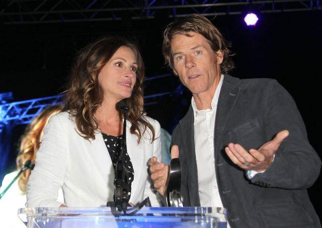 Julia Roberts looking at Danny Moder while they speak on stage.