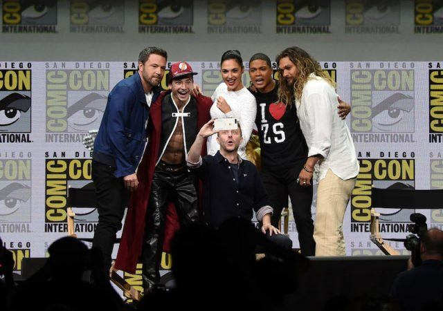 The 'Justice League' cast taking a group photo together.