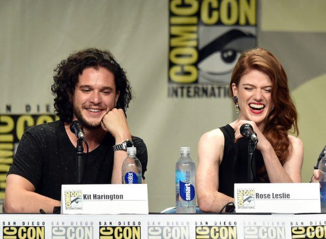 Kit Harington and Rose Leslie sit together and speak while on a Comic-Con pane.