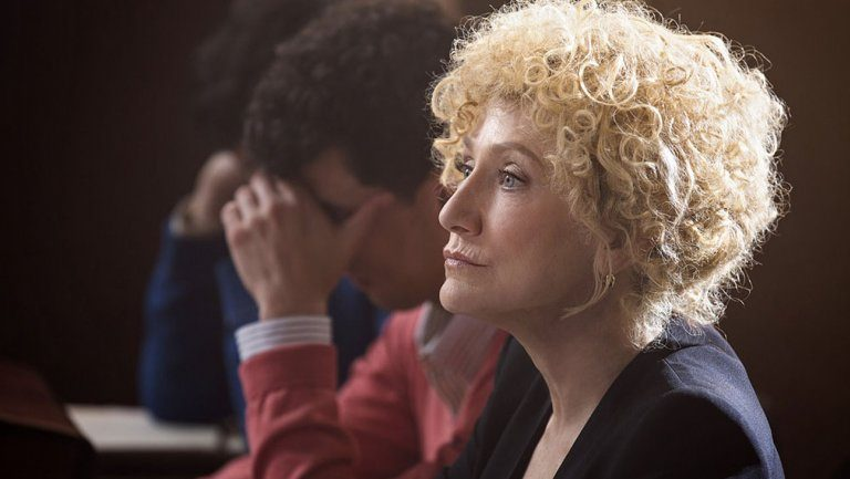 A lawyer sits next to two brothers in Law & Order True Crime: The Menendez Brothers