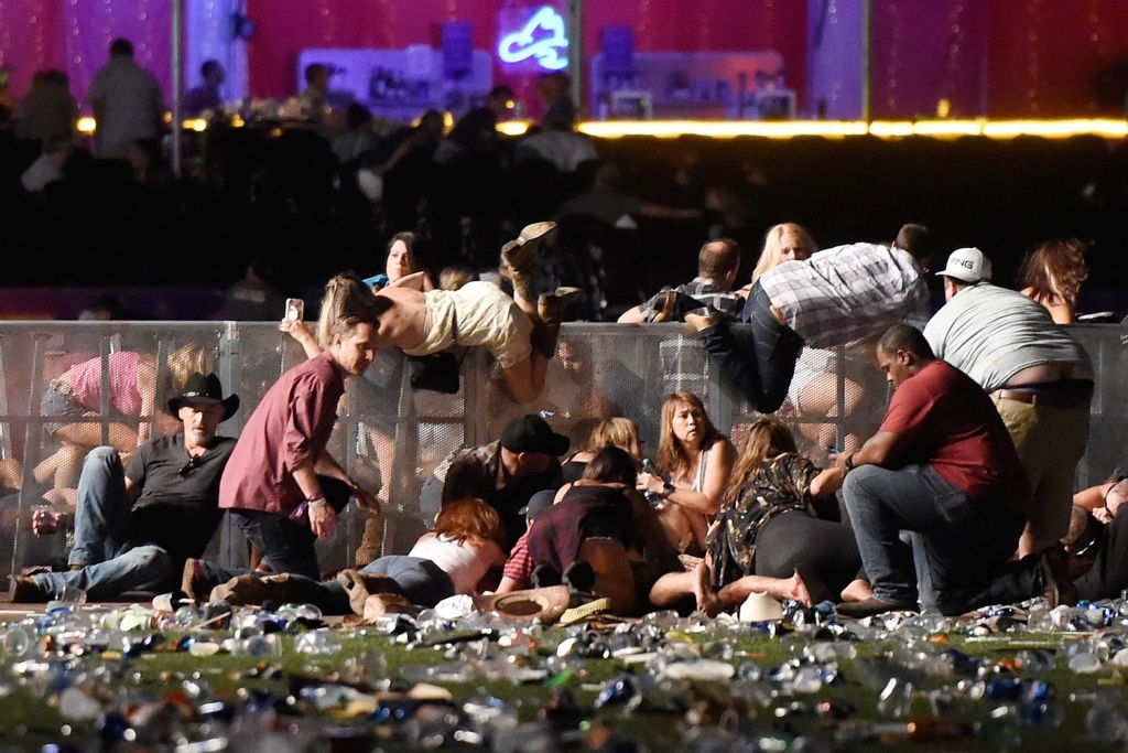People scramble for shelter in a Las Vegas shooting