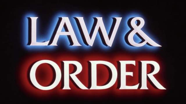 The blue, red and white 'Law & Order' behind a black background.