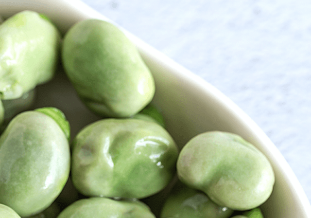 Lima beans on a white plate.