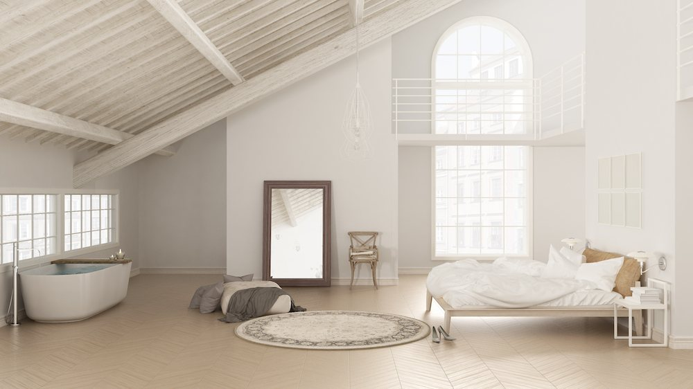Loft bedroom with a large mirror