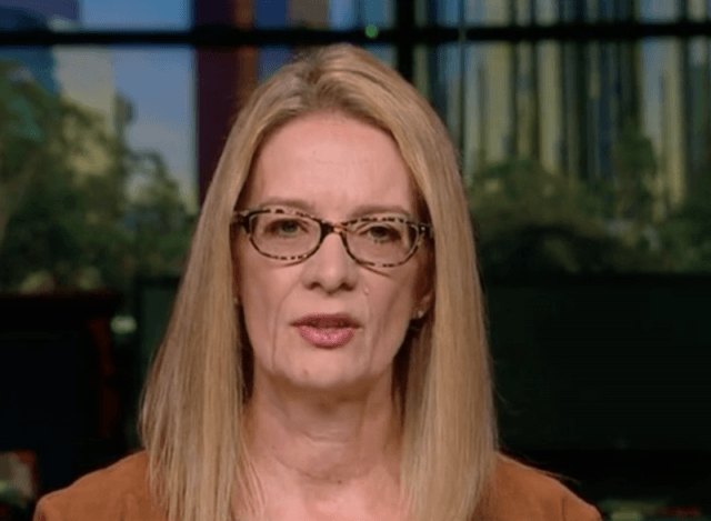 Louise Godbold wearing glasses and staring straight ahead during an interview.