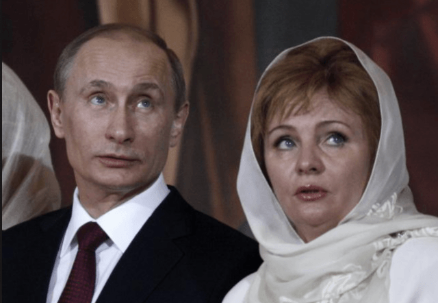 Putin and his wife sitting at a formal event.