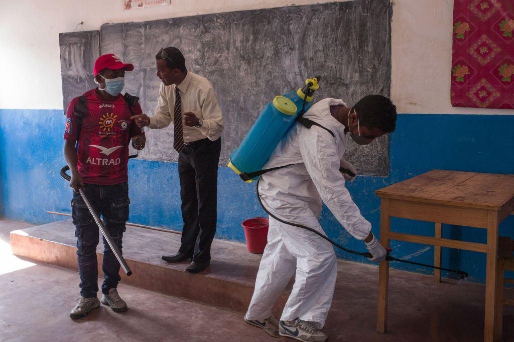 Officers spray pesticide in a Madagascar school