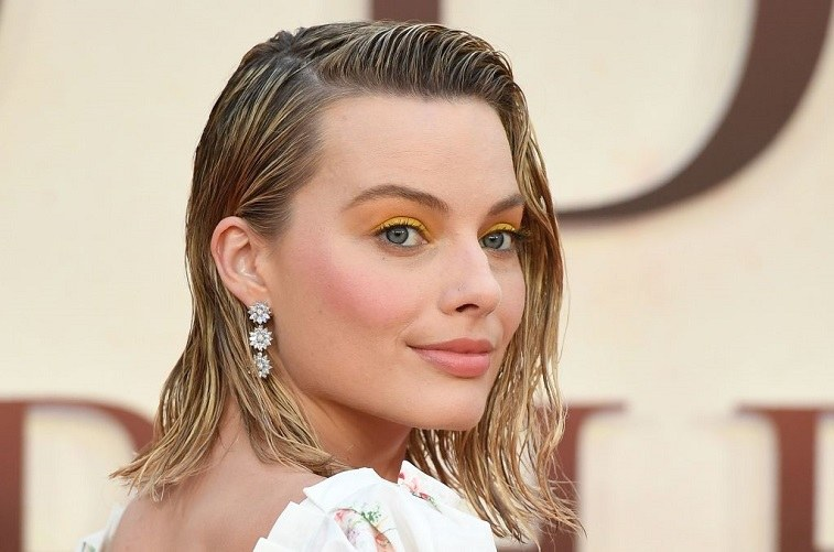 Australian actress Margot Robbie poses upon arrival for the World Premiere of the film, 'Goodbye Christopher Robin' in London on September 20, 2017.