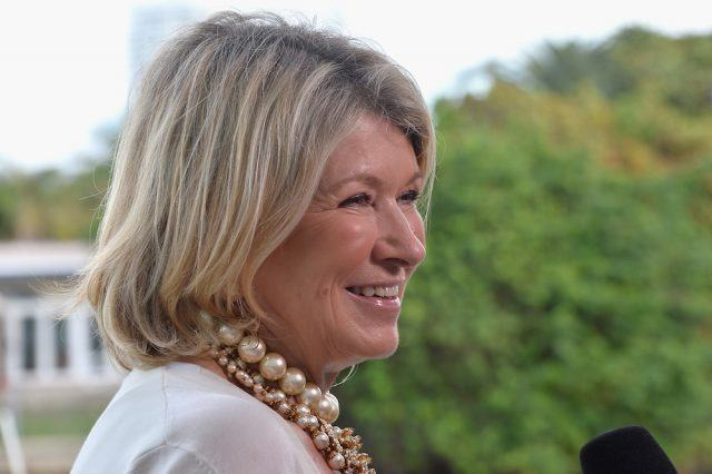 Martha Stewart smiling as she answers interview questions into a microphone.