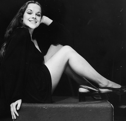 Mary Tamm sitting on a block.