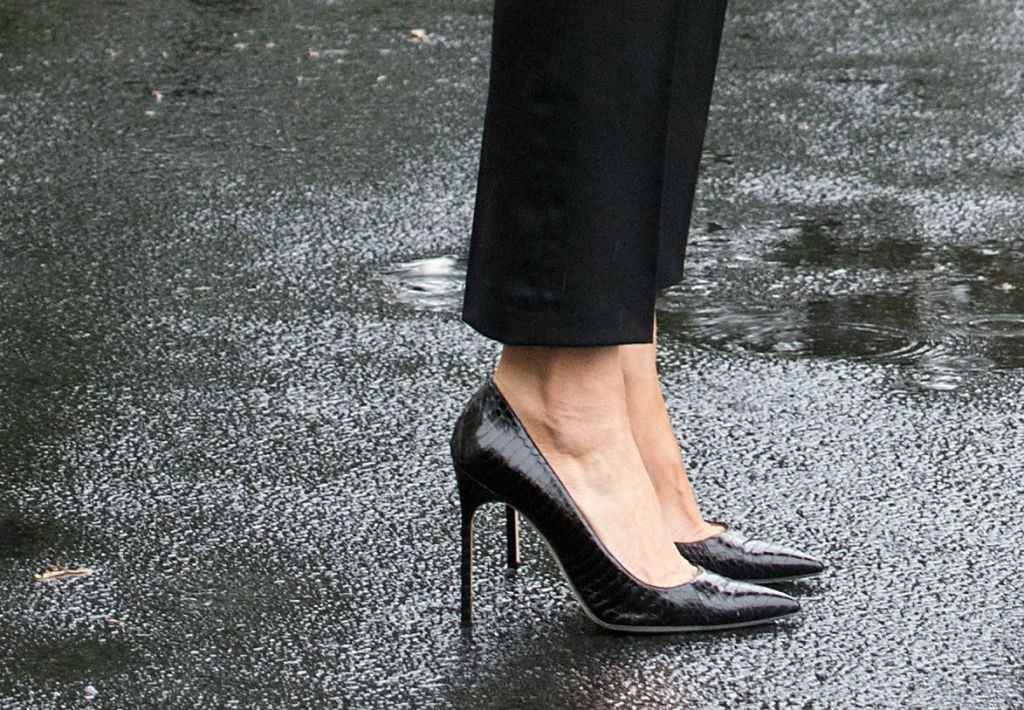 Melania Trump wearing heels in the rain