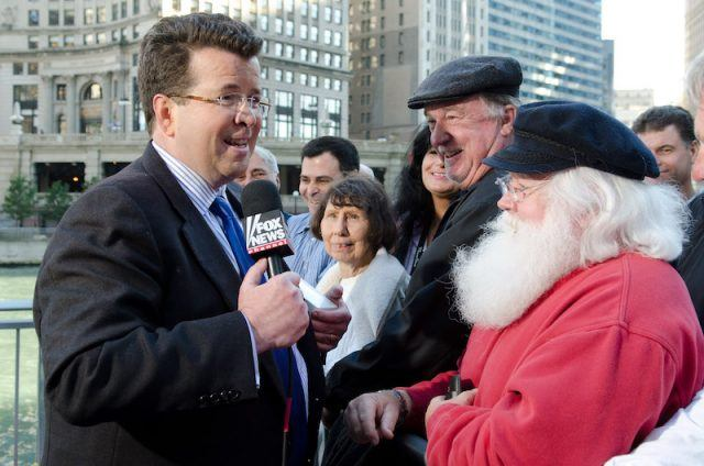 Neil Cavuto holding a microphone while interviewing people outdoors.